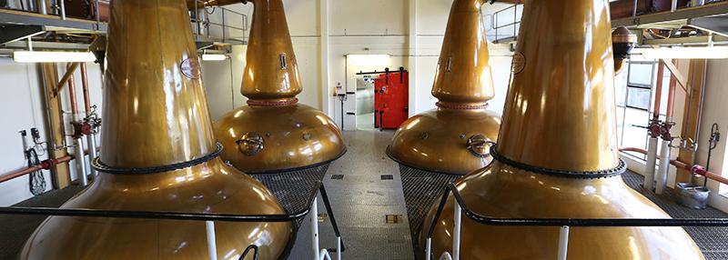 vier distilleerketels vormen de basis van GlenAllachie whisky